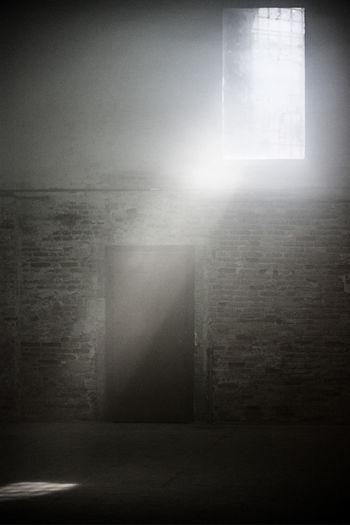 Sunlight streaming through window on wall