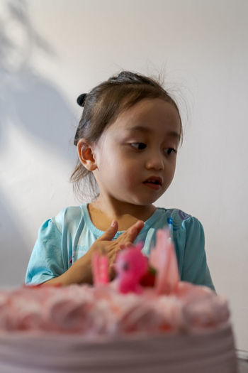 Asian cute little princess at 3rd birthday party.