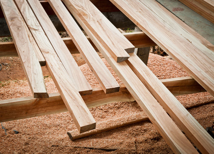 Planks on wooden structure over sawdust
