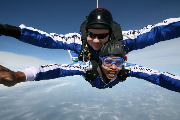 Portrait of men skydiving