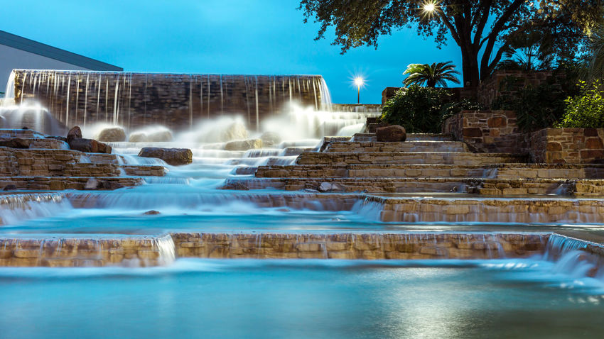 Beautiful city fountain in evening light Architecture Blue Blurred Motion City Fountains Design Drinking Fountain Evening Flowing Water Fountain Long Exposure Motion Night Outdoors Reflection Running Water Sky Smooth Water Splashing Spraying Urban Fountain Water Waterfall Waterfront