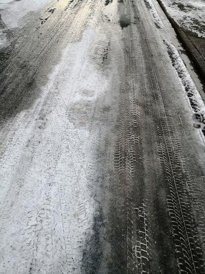 Clear ice black ice on road Road Winter Traffic In Winter Icy Road Frosted Road Clear Ice Black Ice Eisglätte Glatte Straße Slippery Roads Frosted Road Glaze Ice