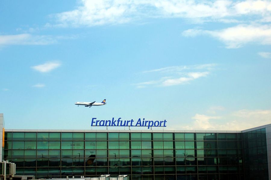 Airplane Airport Frankfurt Architecture Building Building Exterior Cloud - Sky Communication Day Low Angle View Mode Of Transportation No People Outdoors Sky Text Transportation Western Script