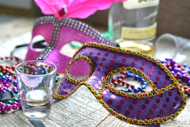 High angle view of purple masquerade mask on table
