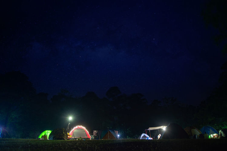 Night Illuminated Nature Sky Tent Group Of People Plant Glowing Outdoors Tree Light - Natural Phenomenon Lighting Equipment Group Medium Group Of People Motion Beauty In Nature Scenics - Nature Arts Culture And Entertainment People Milky Way Star Camping Asmosphere
