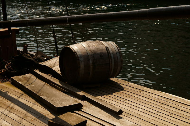 Wood - Material Water Day Nature Sunlight Barrel Cylinder No People Focus On Foreground Outdoors Refreshment Pier Shadow Architecture Metal Drink Wine Cask Food And Drink Winemaking
