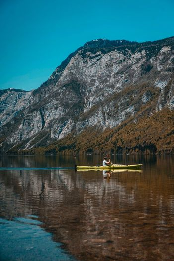 Boating Reflections Bohinj Slovenia Water Mountain Lake Waterfront Nature Nautical Vessel Sky Beauty In Nature Group Of People Day Transportation Scenics - Nature Tree Real People Blue Lifestyles Mode Of Transportation Men Reflection Rowing The Great Outdoors - 2018 EyeEm Awards The Great Outdoors - 2018 EyeEm Awards