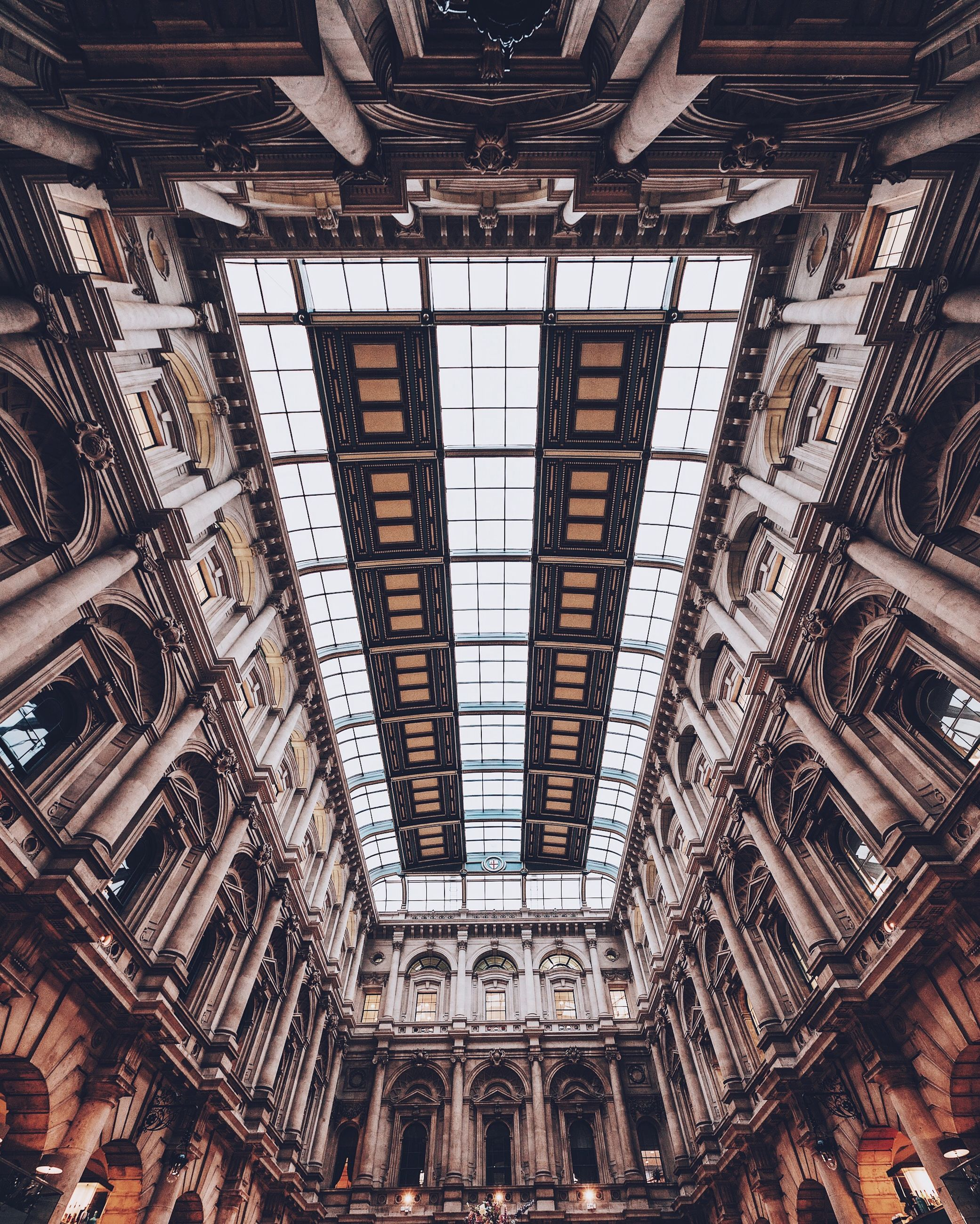 ceiling, architecture, indoors, built structure, low angle view, travel destinations, no people, day, tourism, travel, pattern, building, arch, shopping mall, history, city, architectural feature, the past, architecture and art, ornate, directly below, gothic style