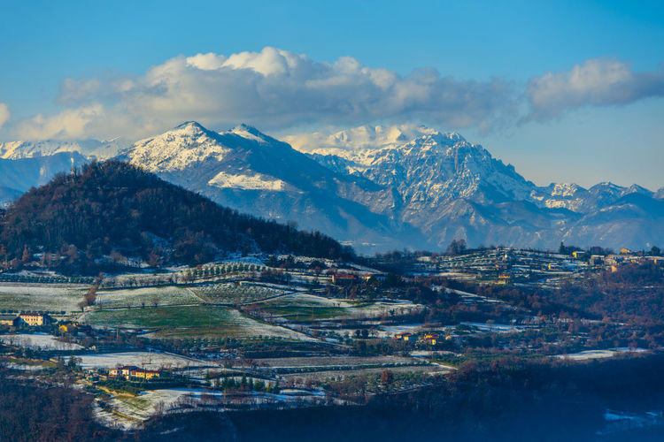 Majestic view of the snow-covered carega complex from the sovizzo hills in vicenza italy