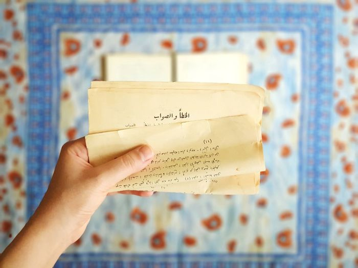 Focused Poem Cultural Oriental Style Poetry Middle East Novel Original Arabic Calligraphy Paper Literature Old Paper Old Books Texting Focus Book Oriental Paper Clip Script Human Hand Old-fashioned Communication Mail Correspondence Blue Typescript Letter Alphabet Envelope Love Letter