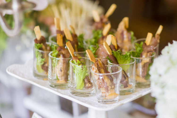 High Angle View Of Meat In Shot Glasses In Cakestand During Wedding