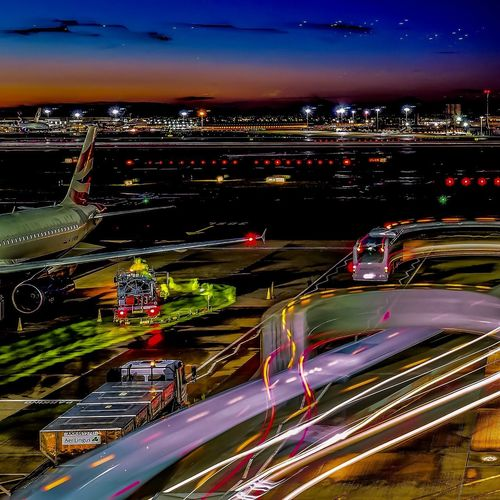 Still the busiest airport in the World London Airport Plane Loading Planes Airport Runway Airport Heathrow Heathrow Airport Illuminated Light Trail Speed Night Long Exposure Transportation Motion