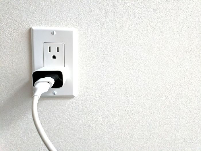 Plugged in. Electricity  Outlet Wall - Building Feature Cable Technology Indoors  Switch Power Supply Close-up No People Cord Charger Charger Cable Charger Cord Technology Addiction Technology Control Us Blackandwhitephotography Black And White Photography Black And White Collection