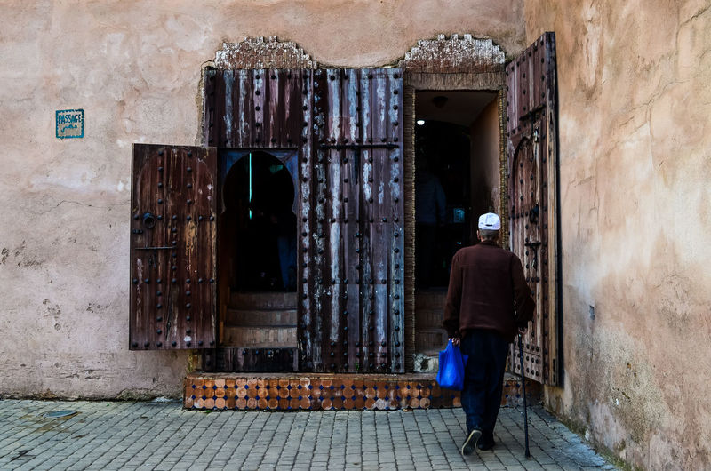 Architecture Built Structure Building Exterior Rear View Full Length Real People One Person Building Walking Entrance Door Wall Lifestyles Day Wall - Building Feature Footpath Adult Men City Outdoors Walking Cane Alley Morocco Meknès Traditional Tradition Architecture Cultures Travel Traveling Photography Afternoon Maroc Meknès City Moulay Ismail