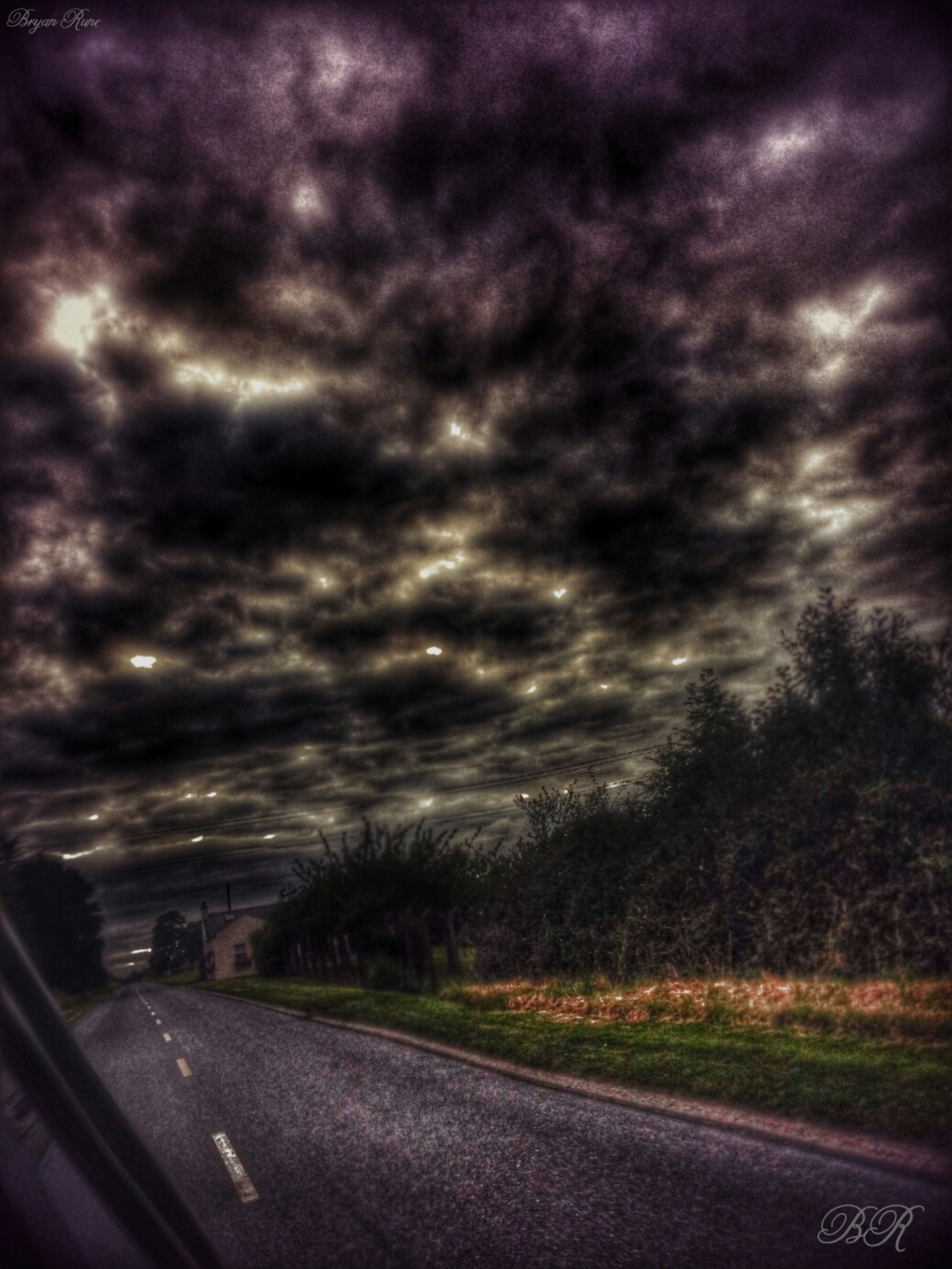 transportation, road, sky, cloud - sky, cloudy, road marking, the way forward, weather, car, overcast, country road, cloud, storm cloud, landscape, street, nature, tree, land vehicle, diminishing perspective, mode of transport