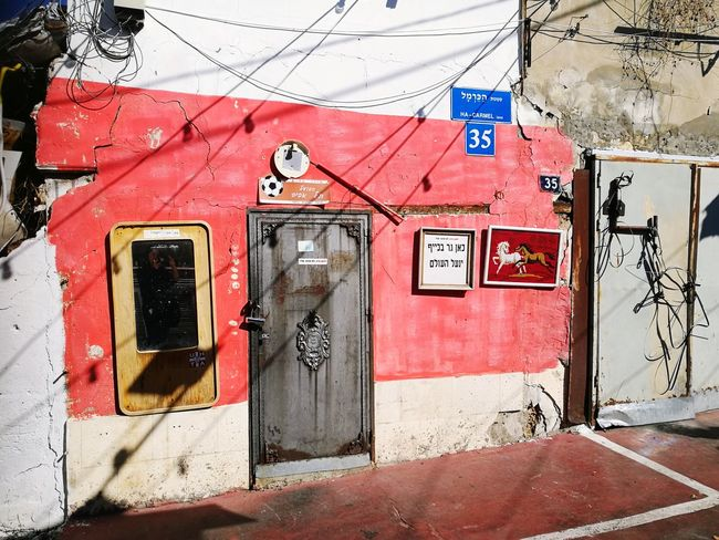 Abandoned Settlement Urban Jungle Street Abandoned Places Middle East Urban Life Summer Feeling Red Architecture Building Exterior Built Structure Closed Entryway Entrance Gate Door Door Handle Wrought Iron Front Door Information Sign Closed Door Doorknob Entry