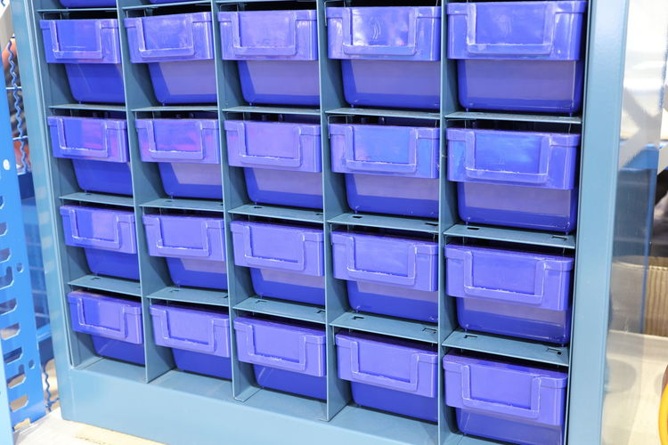 Shelf Indoors  In A Row Container Large Group Of Objects Store Box No People Box - Container Retail  Arrangement Storage Room Business Storage Compartment Domestic Room Order Abundance Side By Side Empty Blue Consumerism