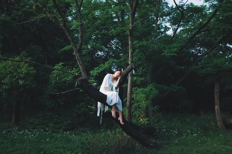 Tree Plant Forest One Person Real People Full Length Growth Young Adult Leisure Activity Land Casual Clothing Lifestyles Nature Green Color Day Adult Standing Young Women Women WoodLand The Week on EyeEm Girl People Of EyeEm People Photography EyeEmNewHere