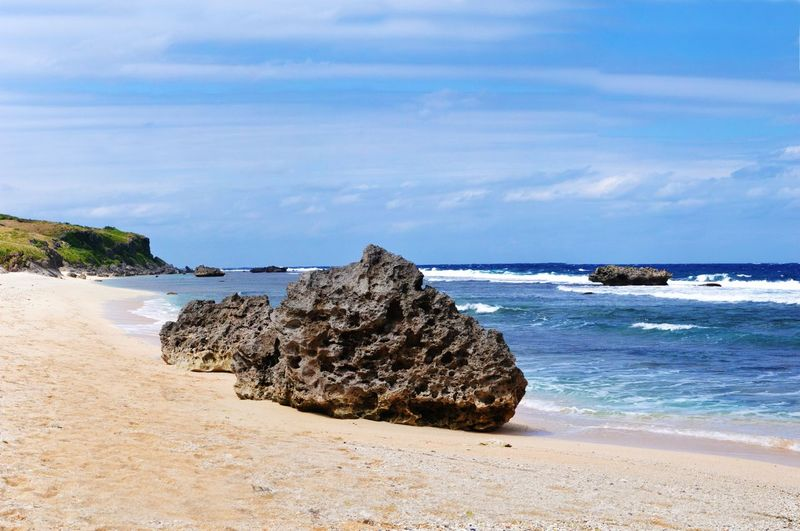 Stack Rocks On Beach Against Sky