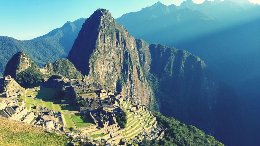 Impressive Machu Picchu at sunrise EyeEm Selects Mountain Rock - Object Mountain Range Nature Outdoors Mountain Peak Travel Destinations Scenics Landscape Steep Cliff Day Beauty In Nature No People Vacations Sky Rock Face First Eyeem Photo Peru Machu Picchu Beauty In Nature Nature Grass