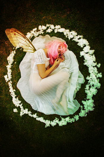 Directly above shot of young woman with dyed hair lying down