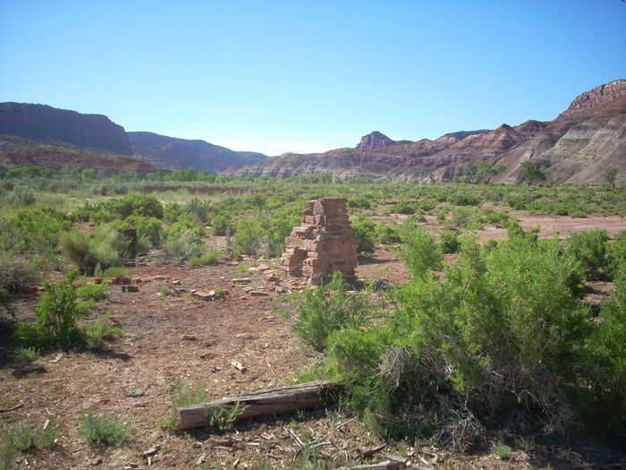 Lone chimney EyeEmNewHere Remains Withstood Alone Forgotten Lonely Arid Climate Arid Landscape Blue Sky Clear Sky Collapsed Fireplace Landscape No People Outdoors Rock Fireplace Test Of Time Time Withered  EyeEmNewHere