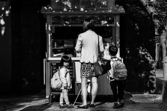 B&w Black & White Blackandwhite Children Childrens Family Food Stand Going To School Kids Mom Mother Parent Parenthood Parenting Single Mom  Single Mother Street Streetfood Togetherness Woman Woman Who Inspire You Showcase April Telling Stories Differently