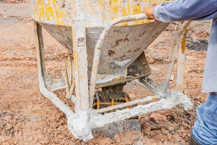 Construction Foundation Industry Liquid Pouring Ready Textured  Workers Building Cement Concrete Contractor Design Equipment Floor Jobs Metal Mixed Mixing Pattern Plasterer Reinforcement Site Structure Wet