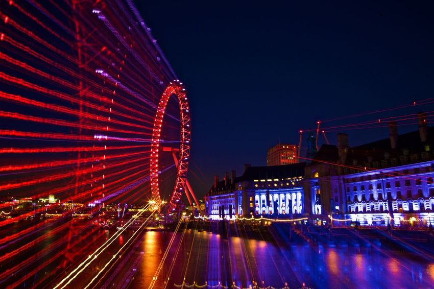 Architecture Building Exterior City Cityscape Ferris Wheel Illuminated London Eye By Night London Eye View Night No People Outdoors Reflection River Sky Urban Skyline Zoom Burst Zoom In Zoom Out Zoom Out Photography
