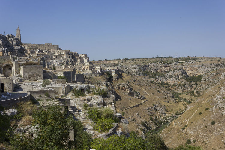 Matera Italy Unesco UNESCO World Heritage Site Landscape Murgia Architecture Sky History The Past Built Structure Ancient Clear Sky Nature Copy Space Day Ancient Civilization Old Ruin Travel Destinations Travel Building Exterior Tourism No People Old Outdoors Building Archaeology Ruined