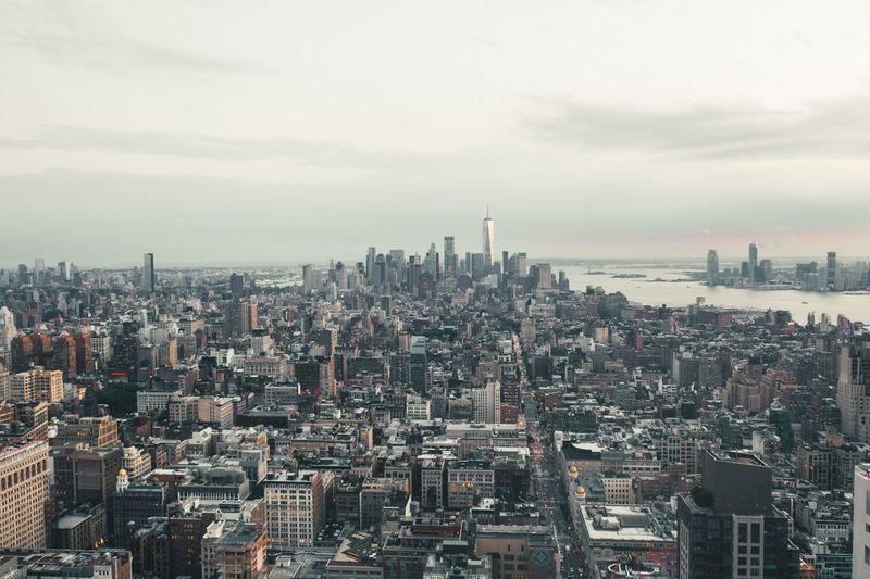 Aerial view of buildings in city against sky in manhattan, new york city