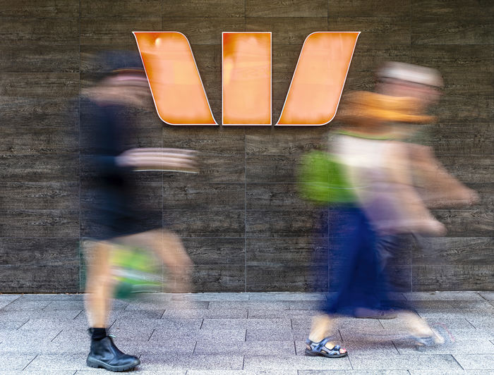 Couple Logo Orange Woman Blurred Motion Motion on the move People Walking Wall - Building Feature