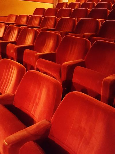 Red empty seats in movie theater