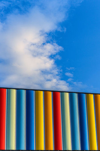 Low angle view of multi colored built structure against sky