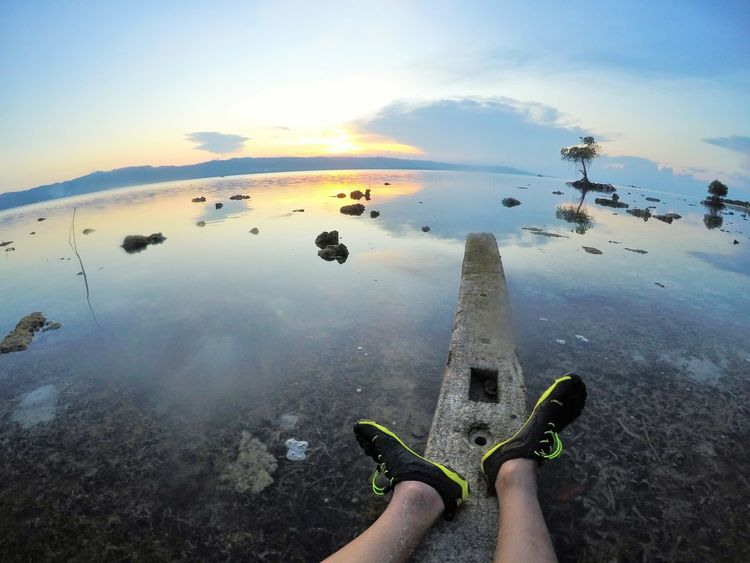 low tide and resting by the sea Beauty In Nature Human Leg Low Tide Mangrove Outdoor Photography Reflection Reflections In The Water Rest & Relax Sea And Sky Seascape