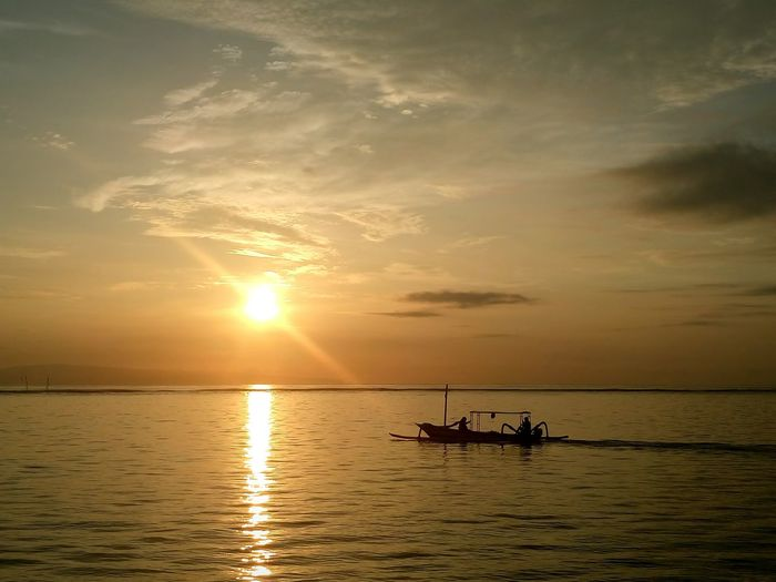 karang beach 📷 Sunrise Nautical Vessel Sun Silhouette Reflection Water Cloud - Sky Tranquility Landscape Sunlight Outdoors Beauty In Nature Dusk Horizon Over Water Sea Sunny Transportation Sky Nature Tranquil Scene Beach Beachphotography Sailing Sailboat