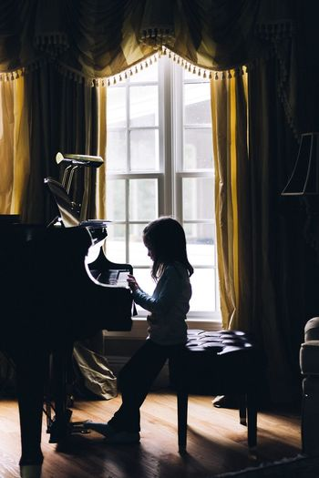 Indoors  One Person Curtain Full Length Window Sitting Side View Real People Day Young Adult Home Interior Concentration Standing Young Women One Young Woman Only One Woman Only Adult Adults Only People Piano Music