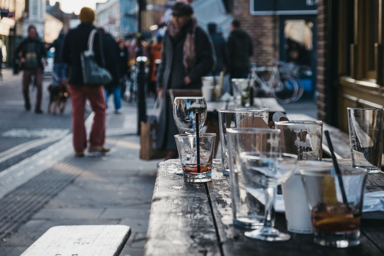 Empty glasses left at an outdoor table of a pub in London, UK. London Uk East London City City Life Weekend Activities Winter Day Drinking Glass Food And Drink Street Focus On Foreground Lifestyles Outdoors Glass Table Drinking Empty Glass Gone Left Many Wineglass Beer Glass Empty Outside The Art Of Street Photography
