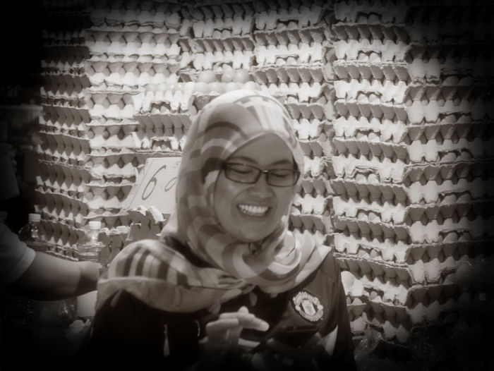 Ibu Telur (Mrs Egg), egg vendor at the marvelous Kota Kinabalu Night Market Kota Kinabalu Adult Brick Wall Cheerful Close-up Day Eggs Eyeglasses  Happiness Head And Shoulders Headshot Human Hand Indoors  Leisure Activity Lifestyles Night Market One Person People Real People Smiling Young Adult Young Women Food Stories The Creative - 2018 EyeEm Awards The Creative - 2018 EyeEm Awards HUAWEI Photo Award: After Dark Moments Of Happiness