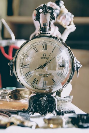 Close-up of clock on table