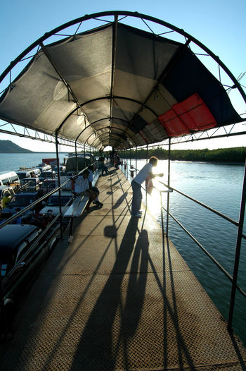 Boat Ferry Thailand Day Ferry Boat Thailand Nature One Person Outdoors Passenger Ferry Thailand People Real People Shadow Sky Sunlight
