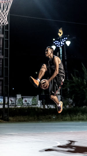 Portrait of Basketball player Action Basketball Basketball Court Basketball Is Life Basketball ❤ Carrying Casual Clothing Flying Handheld Jump Jumping Lay Up Man Mid-air Night Sport Performance Play Portrait Shadow Skill  Sport Sports Photography Sporty Thailand Young Adult