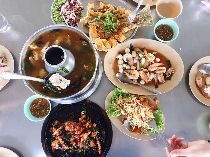 Enjoy to eat Food And Drink Food Freshness Bowl Ready-to-eat Table Serving Size Human Hand Healthy Eating High Angle View Variation Human Body Part Chopsticks Plate Meal Lunch Day Eating Thai Food Dinner Enjoy Eating Food Photography Party Lifestyles