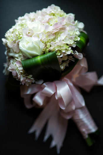 Close-Up Of Flower Bouquet Against Black Background