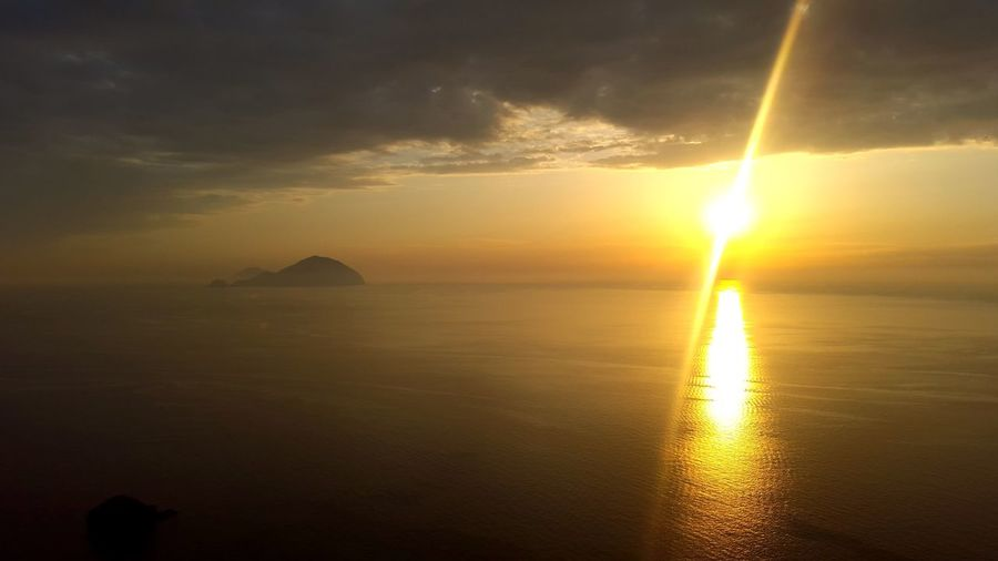 Sunset Reflection Gold Colored Sun Outdoors Architecture Sunlight Cloud - Sky No People Landscape Nature Building Exterior Travel Destinations Scenics Beauty Horizon Over Water Sky Beauty In Nature Refraction Pollara Salina Island Aeolian Islands