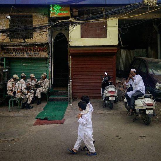Two Indian Muslim children look at a group of cops deployed for security purposes on Eid al-Adha near Jama Masjid, Delhi, as they walk past them. Everydayeverywhere Dailylife Photojournalism Journalism Indiaphotoproject Reportagespotlight _soi Dfordelhi Sodelhi DelhiGram Delhi Newdelhi ASIA India
