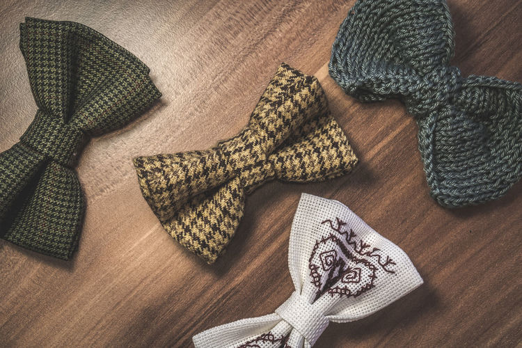 High angle view of bow tie on wooden table