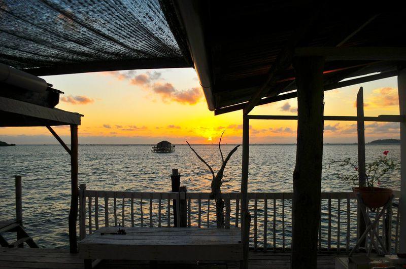 EyeEm Selects EyeEmBestPics Mood Illustration Orange Warm Summer Sunrise_sunsets_aroundworld Sunrise Morning Light Morning Water Sea Sunset Beach Silhouette Nautical Vessel Sun Sailing Ship Sky Horizon Over Water Stilt House Boat Deck Seascape