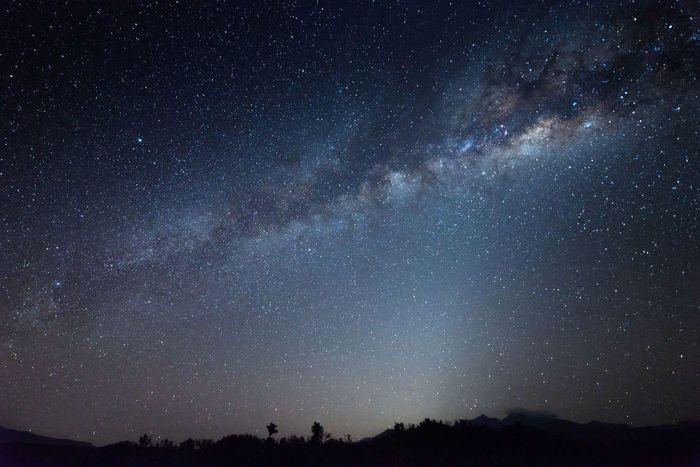 Milky way and starry night with Mount Kinabalu as background at Sabah East Malaysia, North Borneo. Image contain soft focus, blur, grains and noise due wide aperture, long exposure and high ISO. Sabah Milky Way Milkyway Mount Kinabalu Togudon Kota Belud Malangkap Ranau Kundasang Malaysia Borneo North Star Starry Nightscape Scenery Science Landscape Beautiful Background Wallpaper Star Field Height Star Trail Maritime Provinces Sagittarius Astrology Astronomy Telescope Nebula
