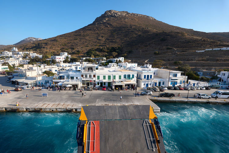 Amorgos Ferry Amorgos Architecture Blue Boat Building Building Exterior Built Structure City Day Greece Katapola Mode Of Transportation Mountain Nature Nautical Vessel No People Outdoors Residential District Sea Sky Transportation Travel Turquoise Colored Water Waterfront